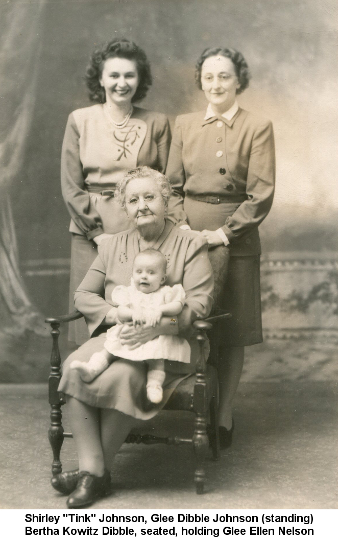 Black & white photo of Shirley 'Tink' Johnson and Glee Dibble Johnson standing behind Bertha Kowitz Dibble, who is seated, holding baby Glee Ellen Nelson