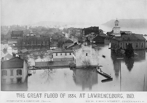 Black and white photograph showing a flooded town; caption reads: 'The Great Flood of 1884, at Lawrenceburg, Ind.'
