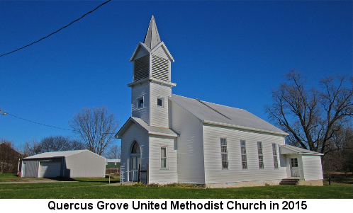Color photo of a traditional white clapboard church with a tall steeple; caption reads: 'Quercus Grove United Methodist Church in 2015'