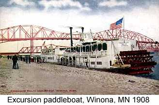 Color postcard photo of paddlewheel excursion boats on the river at Winona, MN in 1908