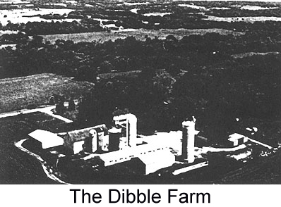 Black and white arial photograph of the Dibble farm, showing barns and outbuildings surrounded by rolling farmland