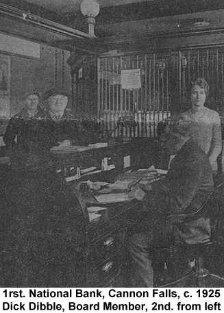 Black and white newspaper photograph of the First National Bank of Cannon Falls interior, showing Dick Dibble leaning on the counter, with some bank employees