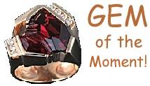A ruby ring studded with small diamonds next to the words 'GEM of the Moment!'