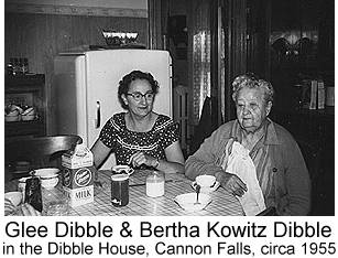 Black & white photo of Glee Dibble and Bertha Kowitz Dibble seated at a table in the dining room of the Dibble House in Cannon Falls, circa 1950