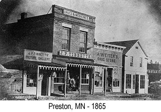 Black and white photo of businesses in Preston, MN in 1865