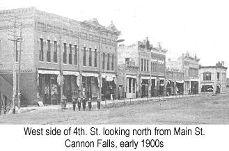 Black and white photograph of the west side of 4th. St., Cannon Falls, looking north from Main St., in the early 1900s
